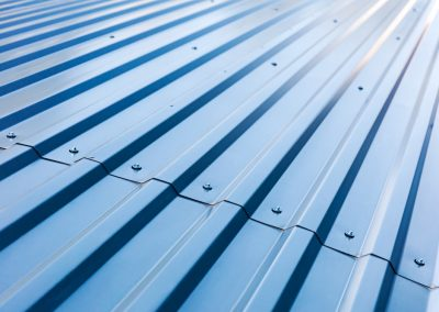blue corrugated metal roof with rivets